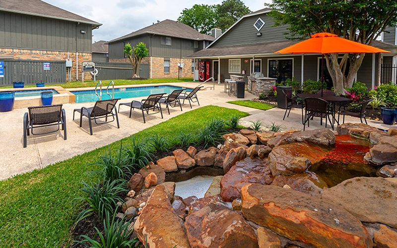 Spacious pool deck with ample seating adjacent to the pool